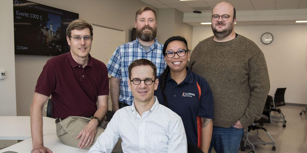CBTF founders, Craig Zilles, far left, Matthew West, foreground center, and Patrick Bailey, back row second from left, join administrative team members, Carleen Sacris and David Mussulman, far right.